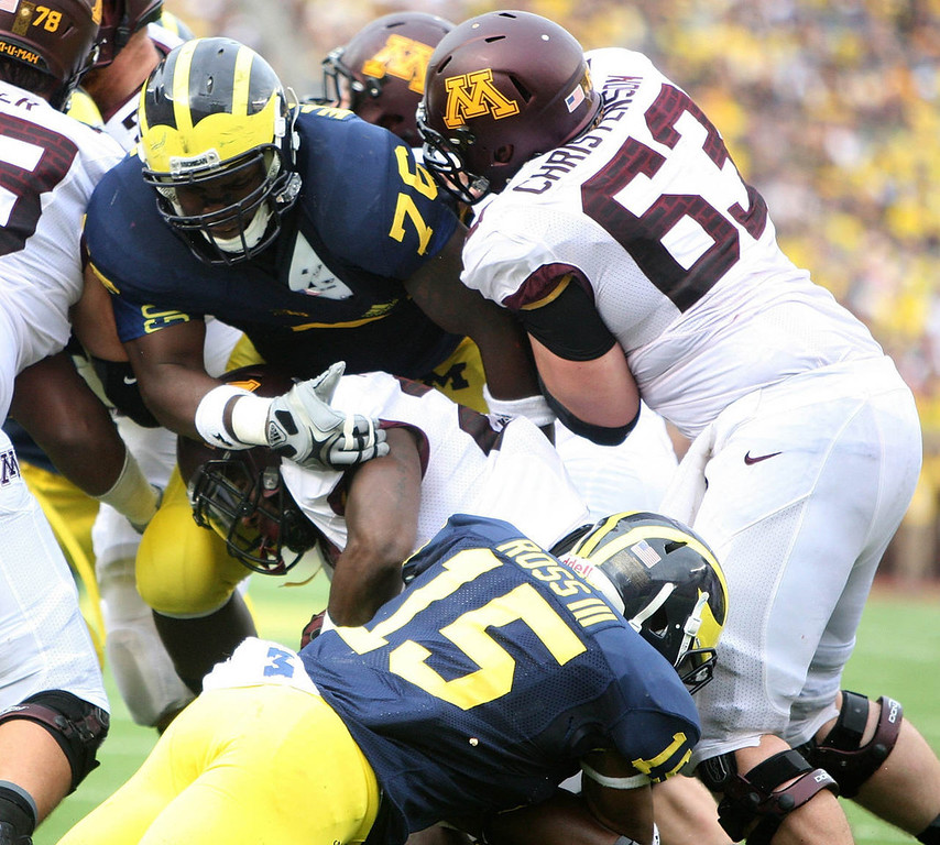 . University of Michigan players Quinton Washington and James Ross III tackle Minnesota\'s David Cobb during the first-quarter. (Kirthmon F. Dozier Detroit/Free Press/MCT)
