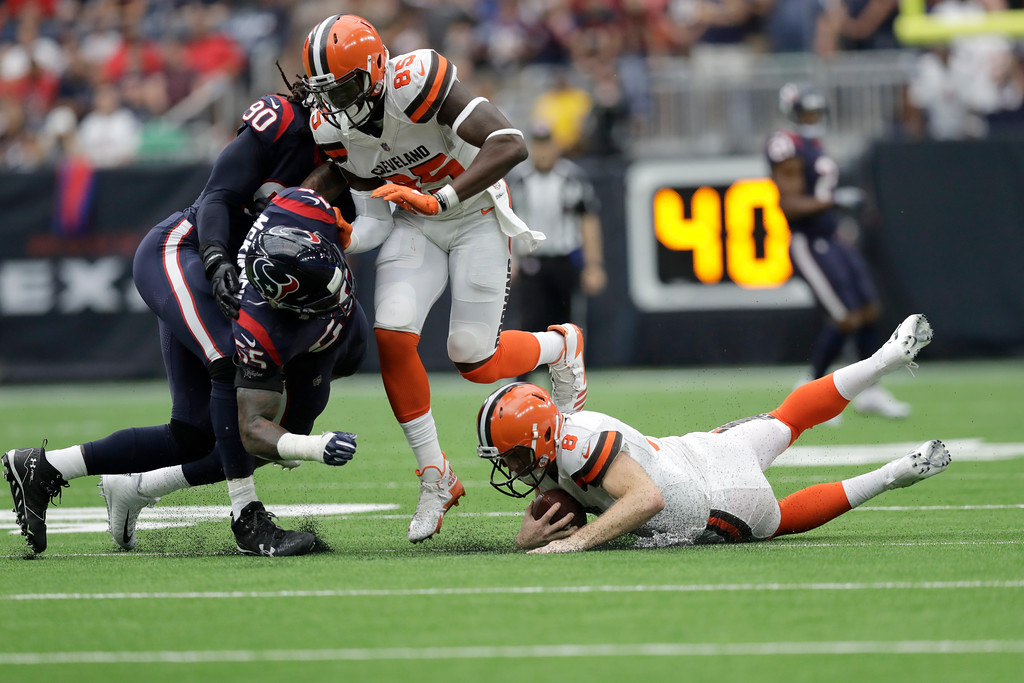 . Houston Texans defensive end Jadeveon Clowney, left, is hit by linebacker Benardrick McKinney (55) as Cleveland Browns tight end David Njoku (85) protects his diving quarterback Kevin Hogan (8) in the first half of an NFL football game, Sunday, Oct. 15, 2017, in Houston. (AP Photo/Eric Gay)