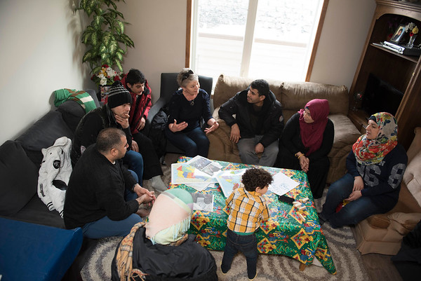 DAVID LIPNOWSKI / WINNIPEG FREE PRESS   DAVID LIPNOWSKI / WINNIPEG FREE PRESS   Val Schellenberg volunteers offering in-home English conversation classes to Syrian refugee families at the home of Fadel and Rania Ahmad January 17, 2017. The refugees from Syria arrived in Canada last February.