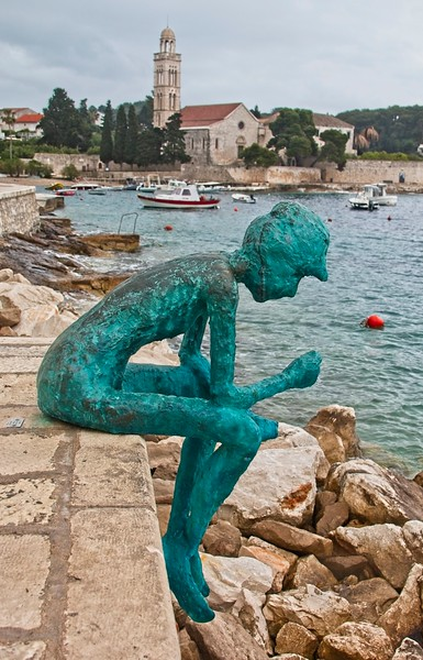 Sitting Fisherman Statue, Hvar, Croatia