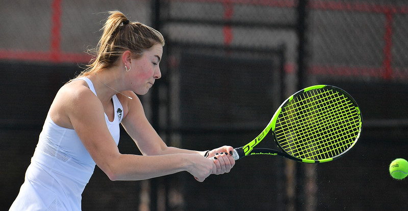 LAS VEGAS, NV - JANUARY 20:  Quinty Janssen of the New Mexico State Aggies plays a backhand during her match against Morgan Dickason of the Weber State Wildcats at the Frank and Vicki Fertitta Tennis Complex in Las Vegas, Nevada. Janssen won the match 4-6, 6-0, 6-3.