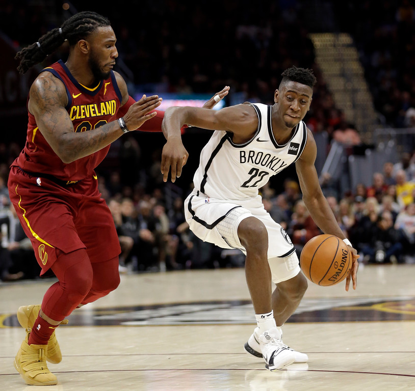. Brooklyn Nets\' Caris LeVert (22) drives around Cleveland Cavaliers\' Jae Crowder (99) in the first half of an NBA basketball game, Wednesday, Nov. 22, 2017, in Cleveland. (AP Photo/Tony Dejak)