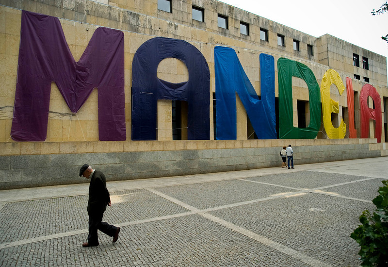 . An man walks past a banner with the name of former South African President Nelson Mandela in Matosinhos City Hall, Matosinhos, Portugal Thursday, July 18, 2013. South Africa celebrated Nelson Mandela\'s 95th birthday on Thursday, a milestone capped by news that the former president\'s health was improving after fears that he was close to death during ongoing hospital treatment. (AP Photo/Paulo Duarte)