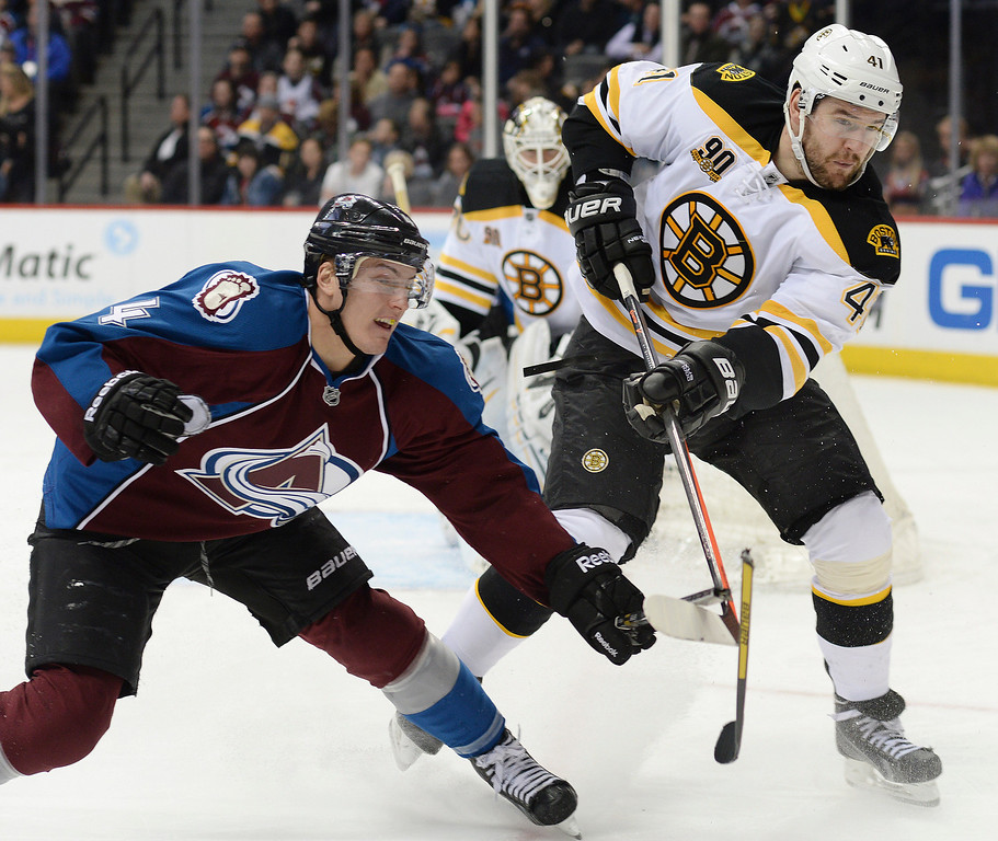 . Boston defenseman Andrej Meszaros (41) broke the stick of Colorado\'s Tyson Barrie (4)  in the third period. The Boston Bruins blanked the Colorado Avalanche 2-0 at the Pepsi Center Friday night, March 21, 2014. (Photo by Karl Gehring/The Denver Post)