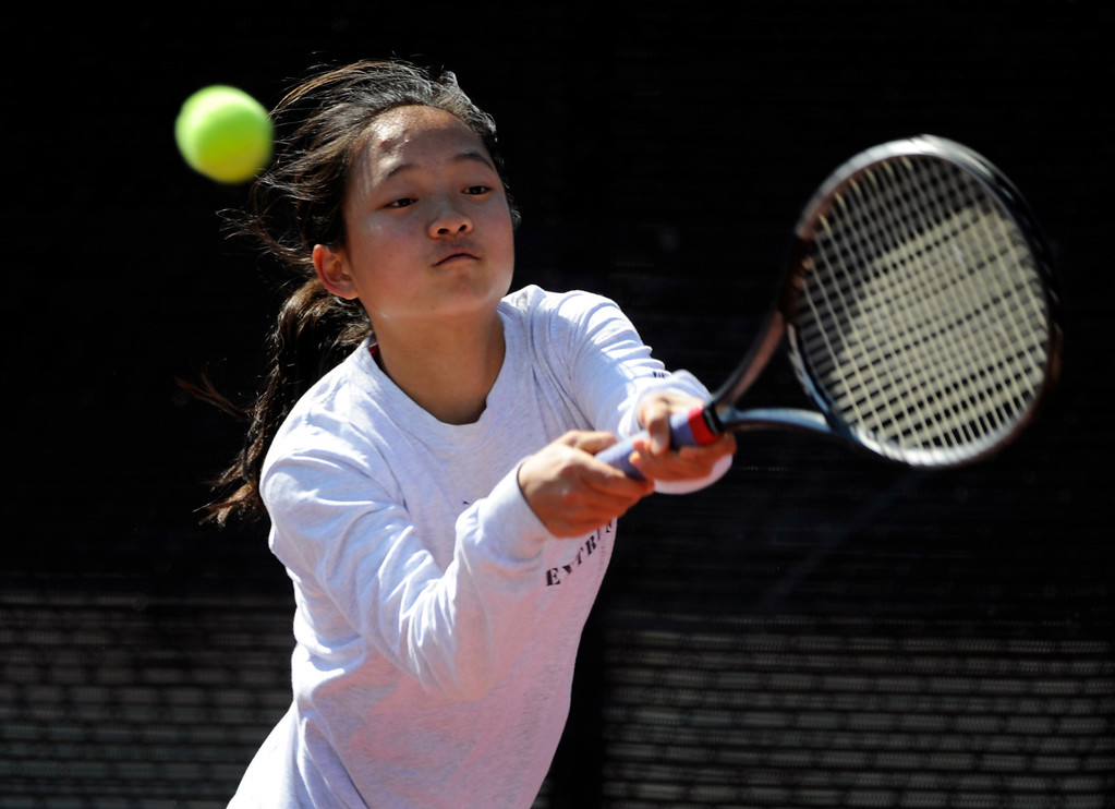 . Katie Li from Fairview High School returns the ball to Angelica Buczynski from ThunderRidge High School in the #3 Singles Bracket.  (Photo By Kathryn Scott Osler/The Denver Post)