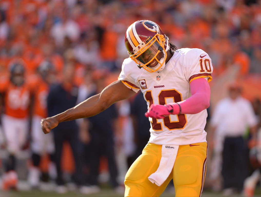 . Washington Redskins quarterback Robert Griffin III (10) celebrates his second quarter touchdown pass.  (Photo by John Leyba/The Denver Post)