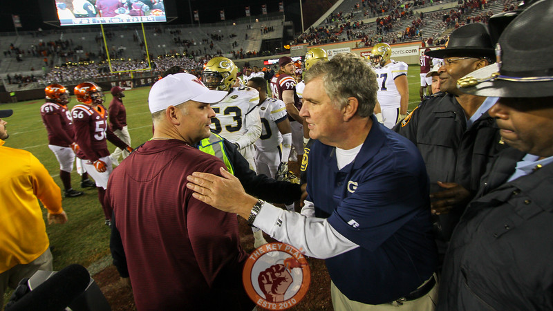 Virginia Tech head coach Justin Fuente (left) shakes hands with Georgia Tech head coach Paul Johnson (right) after the final whistle. Georgia Tech defeated Virginia Tech 30-20. (Mark Umansky/TheKeyPlay.com)