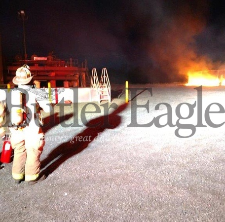 A Unionville volunteer firefighters looks on at a blaze Wednesday morning that destroyed two storage sheds at the Stonehenge Appalachia pipeline compressor station in Clay Township. No one was injured.