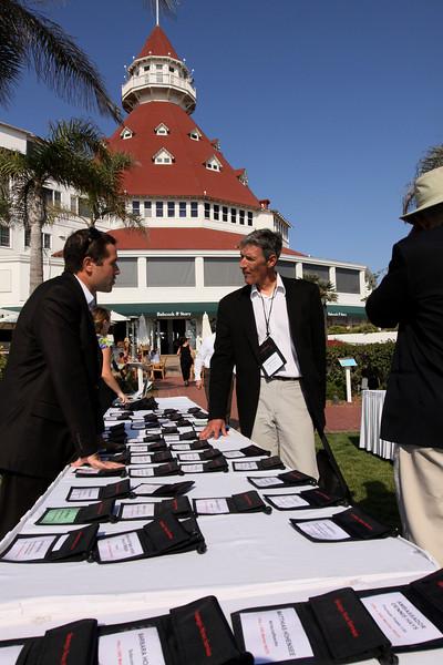 FiRe/Thunderbird intern Matt Keller (L) greets Lewis Douglas, Managing Director of Ocean Alliance, in front of the Hotel del Coronado's iconic ballroom turret