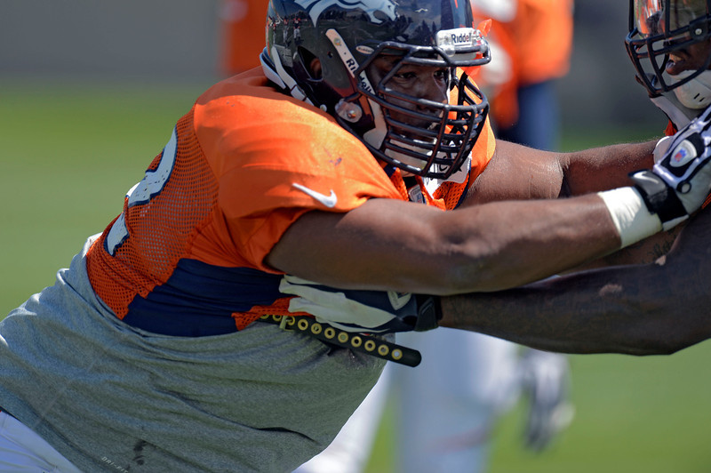 . Denver Broncos NT Sylvester Williams (92) hits the sled in drills during training camp August 12, 2013 at Dove Valley. (Photo By John Leyba/The Denver Post)