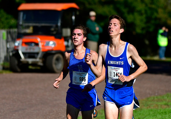 10/16/2018 Mike Orazzi | Staff Hall's Jackson Grady and Southington's Matt Penna during the CCC Conference Cross Country Championships in Manchester's Wickham Park Tuesday.