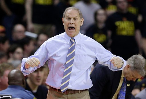 . Michigan head coach John Beilein reacts in the first half of an NCAA college basketball game against Maryland, Saturday, Feb. 28, 2015, in College Park, Md. (AP Photo/Patrick Semansky)