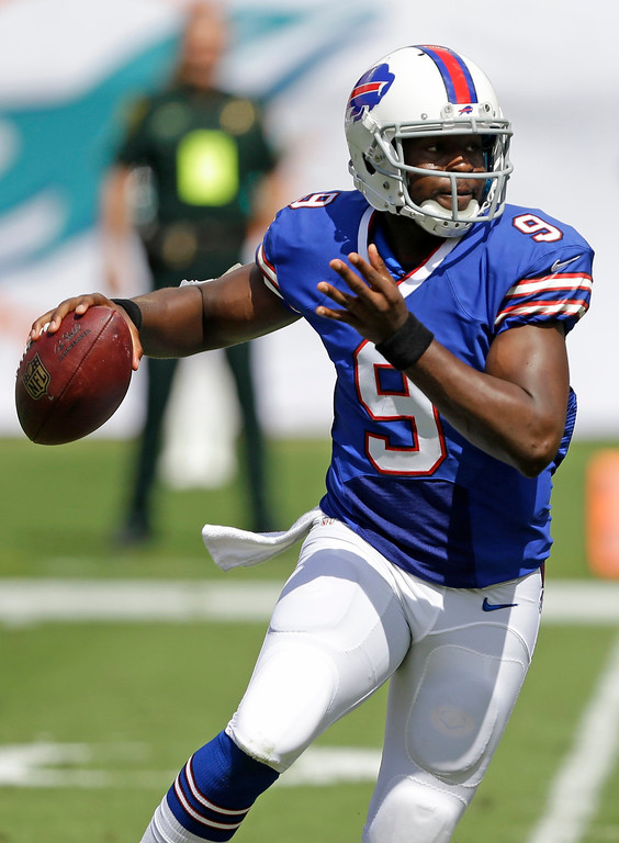 . Buffalo Bills quarterback Thad Lewis (9) looks to pass during the first half of an NFL football game against the Miami Dolphins, Sunday, Oct. 20, 2013, in Miami Gardens, Fla. (AP Photo/Wilfredo Lee)