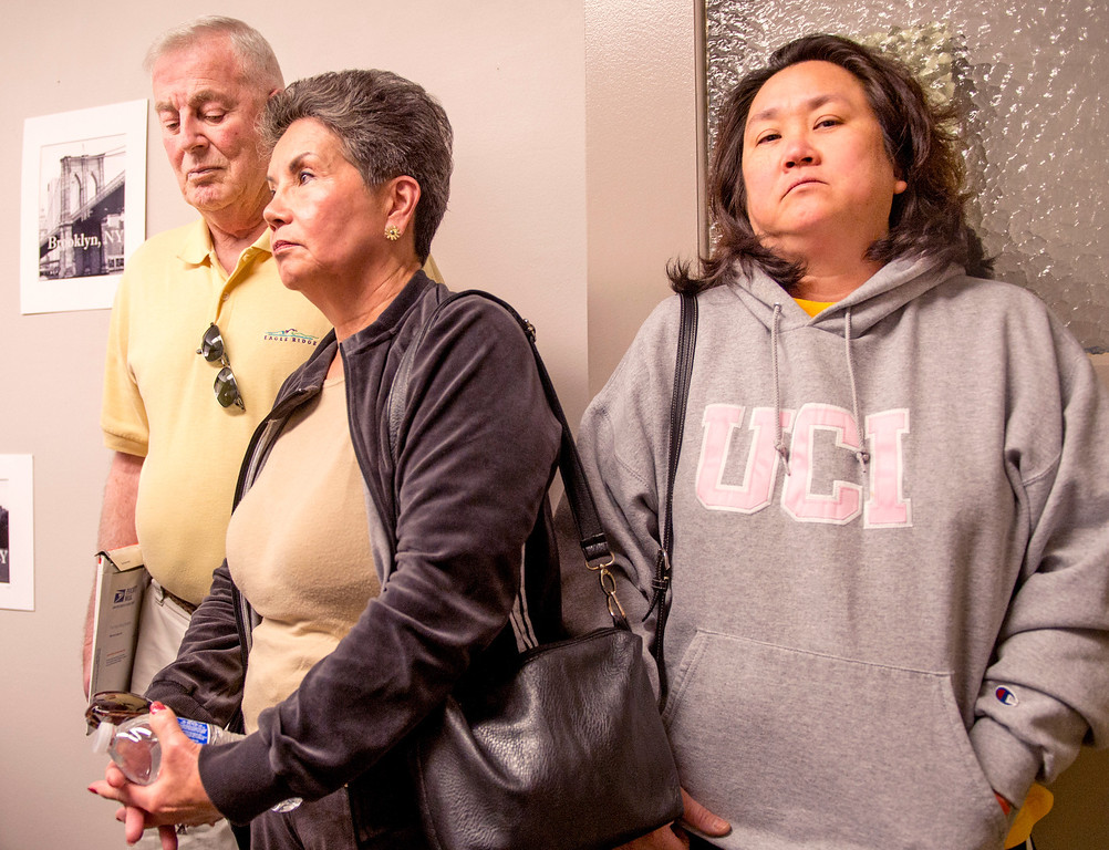 . Relatives of hit-and-run fatality victim Aguida Luna meet with the news media at the CHP Baldwin Park Station to ask for public help in finding the driver of a 1994-1997 Acura Integra that may have been involved in the Nov. 27, 2013 accident on Citrus Avenue in incorporated Azusa.  Luna\'s sister Carla Azerz, right, with in-laws Felicidad and Robert McIntosh Dec. 4, 2013.  (Staff photo by Leo Jarzomb/San Gabriel Valley Tribune)