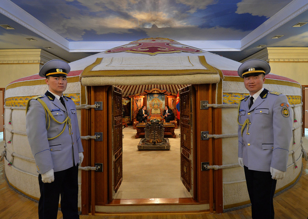 ". Mongolian President Elbegdorj Tsahia (inside R), who received a Champion of the Earth award for policy leadership in 2012 talks with United Nations Environment Program director Achim Steiner (L) inside a traditional ""ger\"" at the State Palace in Ulan Bator, Mongolia on June 3, 2013.  The city is gearing up for World Environment Day which falls on June 5th. MARK RALSTON/AFP/Getty Images"