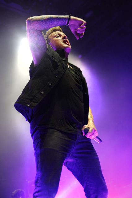 Description of . Jacoby Shaddix of Papa Roach performs in the Carnival of Madness tour at DTE Energy Music Theatre in Independence Twp., on Aug. 27, 2013. Photo by Ken Settle