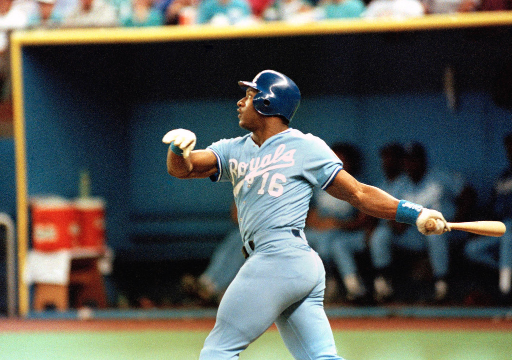 . Kansas City Royal Bo Jackson watches his 26th home run of 1989 clear the fence in right field during second inning action against the Seattle Mariners in Seattle on Sunday, August 21, 1989. Kansas City Royals beat  Seattle 5-4 completing a four-game sweep against the Mariners. (AP Photo/Jim Davidson)