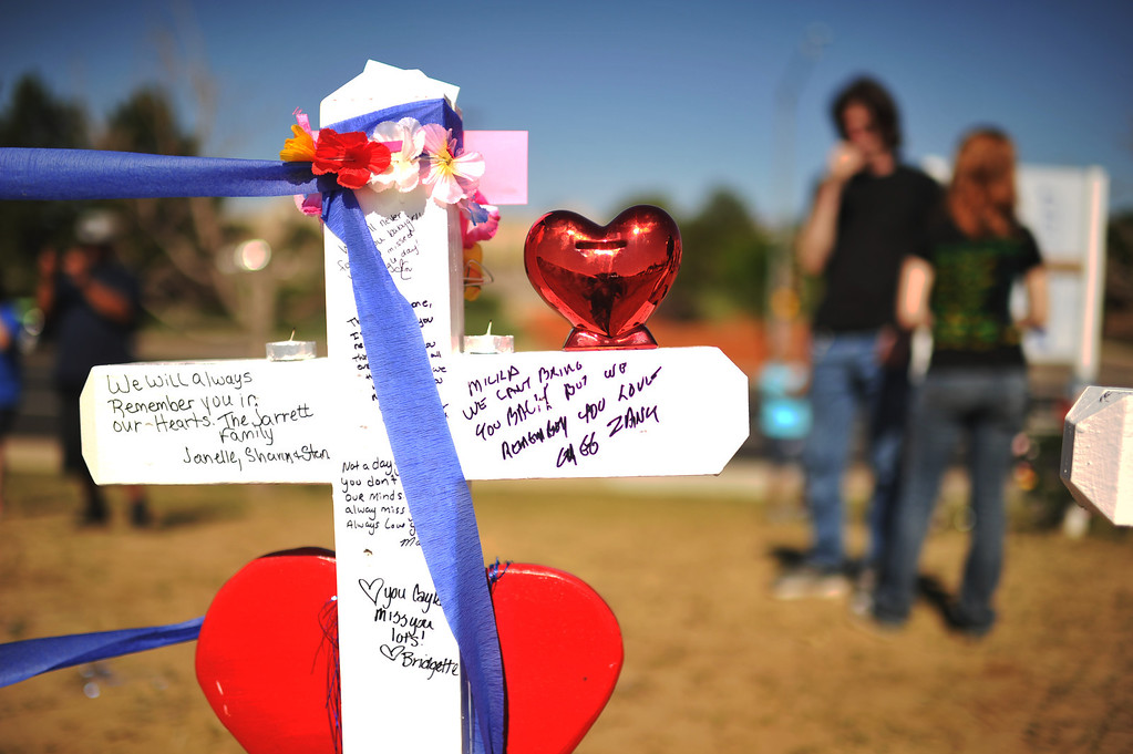. AURORA, CO. - July 20: People visit the memorial site next to the movie theater. Aurora, Colorado. July 20, 2013. People gathered outside the Aurora Municipal Center to mark the first anniversary of the deaths of 12 people and the injury of at least 70 others in a mass shooting that forever changed an entire community. (Photo By Hyoung Chang/The Denver Post)