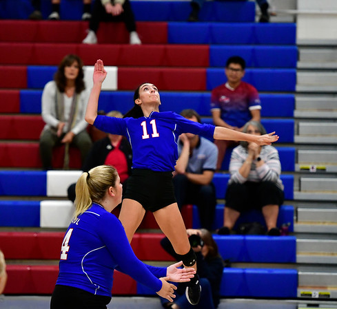 10/11/2019 Mike Orazzi | StaffrSt. Paul's Olivia Genovese (11) during Thursday nights girls volleyball with Torrington in Bristol.