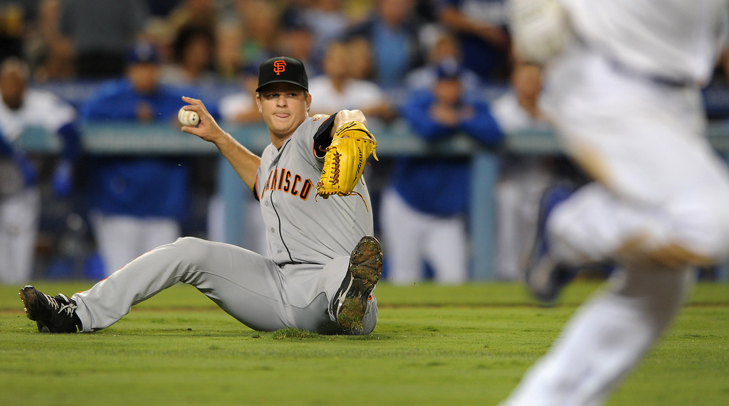 . Giants\' pitcher Matt Cain throws out the Dodgers\' Mark Ellis after slipping while fielding his sacrifice in the seventh-inning, Thursday, September 12, 2013, at Dodger Stadium. (Photo by Michael Owen Baker/L.A. Daily News)