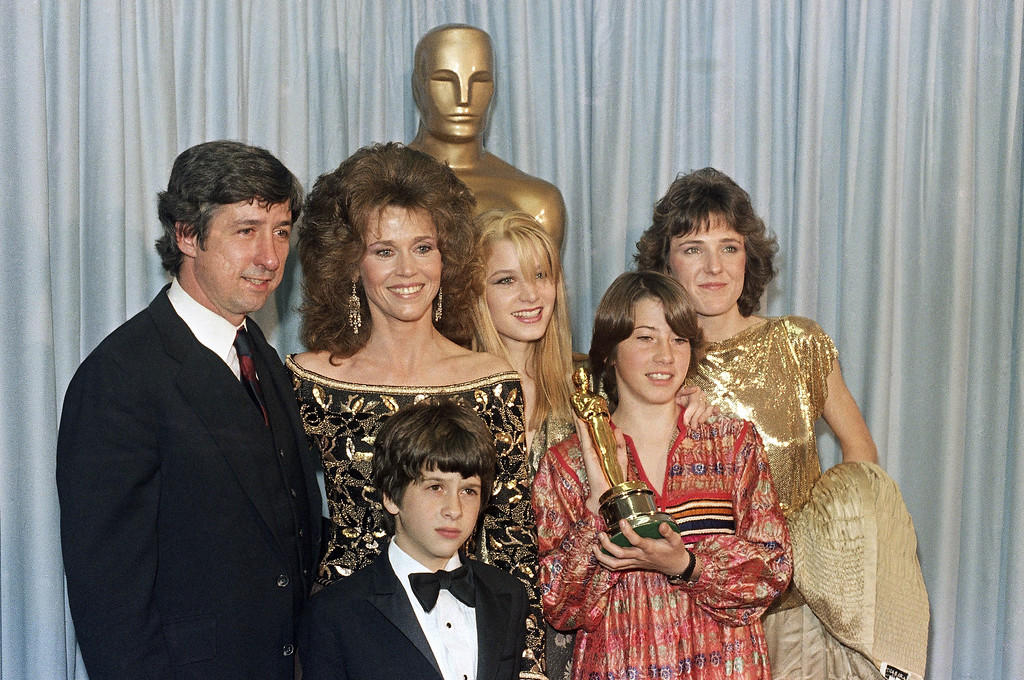 . Members of the Jane Fonda-Tom Hayden clan gather after Jane accepted Oscar on behalf of her dad, Henry Fonda, at the 54th Annual Academy Awards in Los Angeles, March 29, 1982.   Boy is Troy Garrity, 8; 18-year-old Brigitte Fonda behind Jane, Vanessa Fonda, 11, holding award, and Amy Fonda. (AP Photo/Reed Saxon)