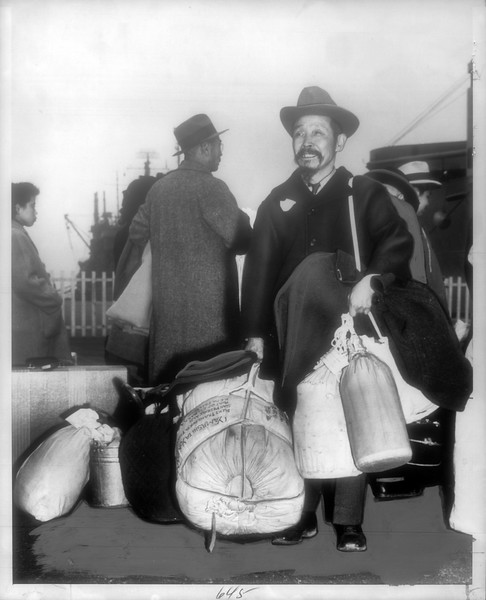 """""""Going Home -- Wearing beard, S. Yamashita lines up with other repatriates on deck.  He is 69 and said 'I go home to die'.""""--caption on photograph"""