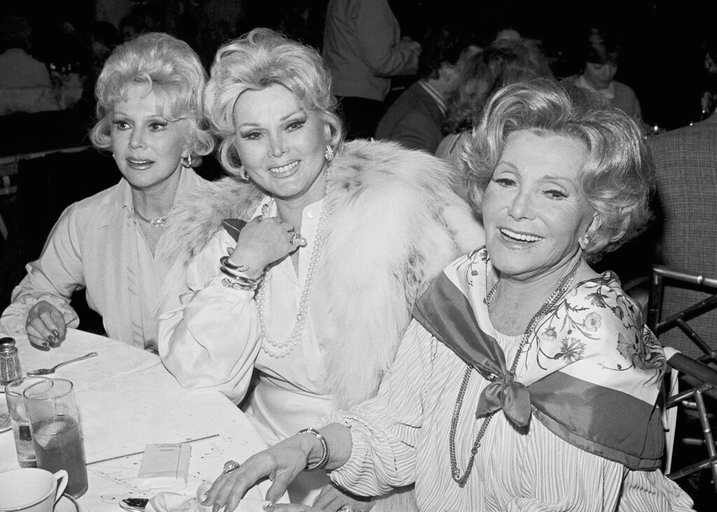 . Eva, left, Zsa Zsa, center, and their mother Jolie Gabor, right, attends a fashion show benefit for the Daniel Freeman Hospital on Thursday, March 16, 1979 in Beverly Hills, California. Jolie Gabor was one of the models. (AP Photo/George Brich)