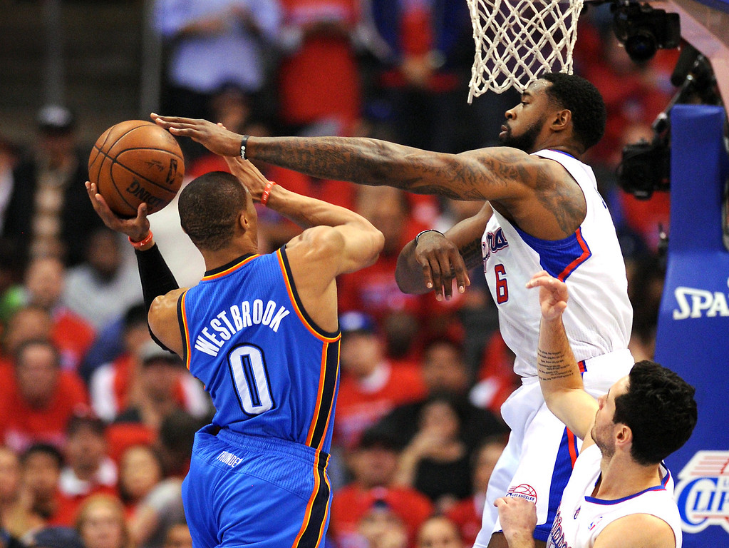 . The Clippers\' DeAndre Jordan defends the hoops against the Thunder\'s Russell Westbrook, Friday, May 9, 2014, at Staples Center. (Photo by Michael Owen Baker/Los Angeles Daily News)