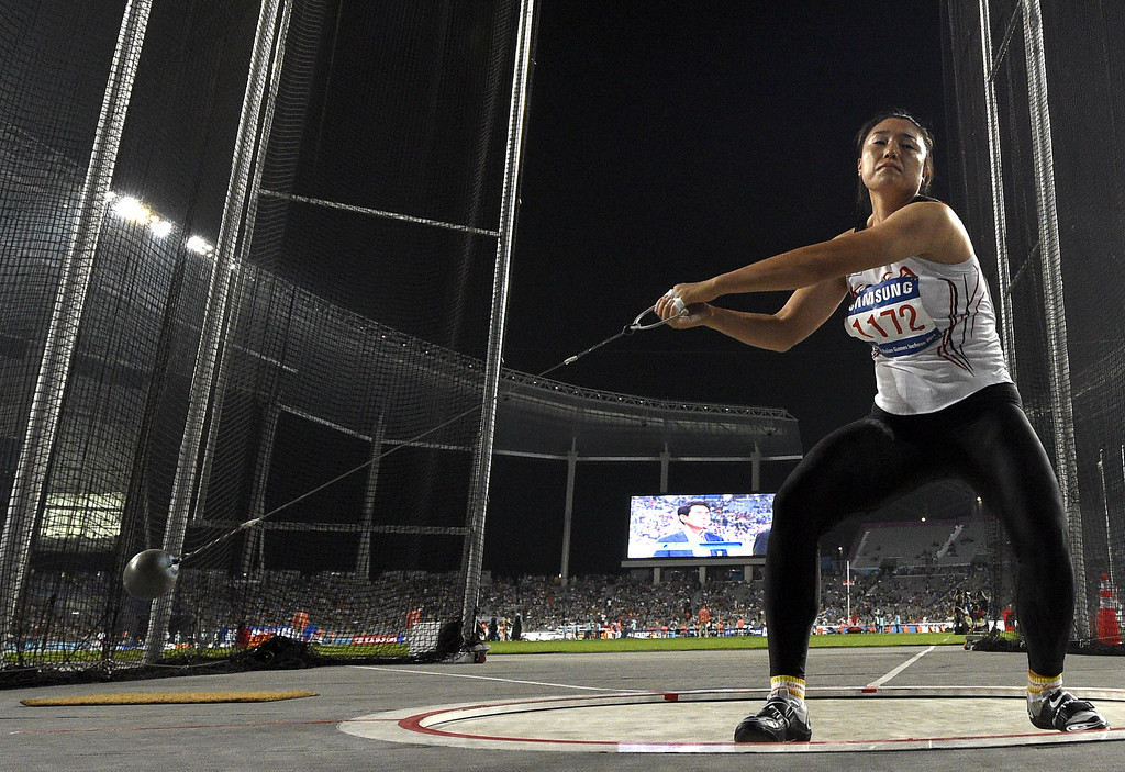 . South Korea\'s Kang Naru competes in the final of the women\'s hammer throw athletics event during the 17th Asian Games at the Incheon Asiad Main Stadium in Incheon on September 28, 2014. MARTIN BUREAU/AFP/Getty Images