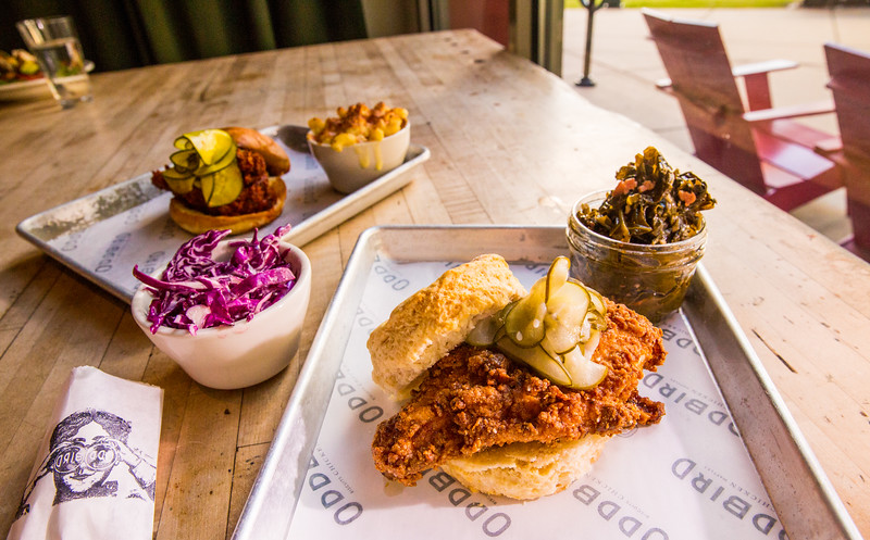 At the pop-up restaurant Oddbird, chicken biscuits can be served with cole slaw, mac and cheese and country ham collard greens.  The fried chicken is offered plain, hot or too hot (for the spicy fans).  Oddbird is found popping up at West Egg off Howell Mill on the second Wednesday. (Jenni Girtman / Atlanta Event Photography