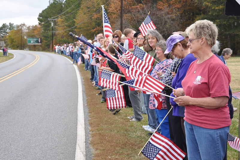 HWY 150 lined with American flags