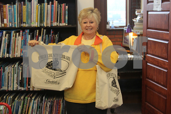 Clinchfield Credit Union Donates Book Bags to Library - April 2014