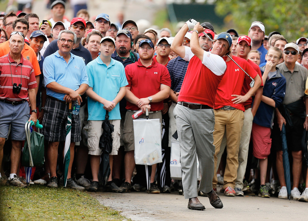 . Phil Mickelson of the United States of the U.S. Team hits a shot off a cart path on the 17th hole during the Day Four Singles Matches at the Muirfield Village Golf Club on October 6, 2013  in Dublin, Ohio.  (Photo by Gregory Shamus/Getty Images)