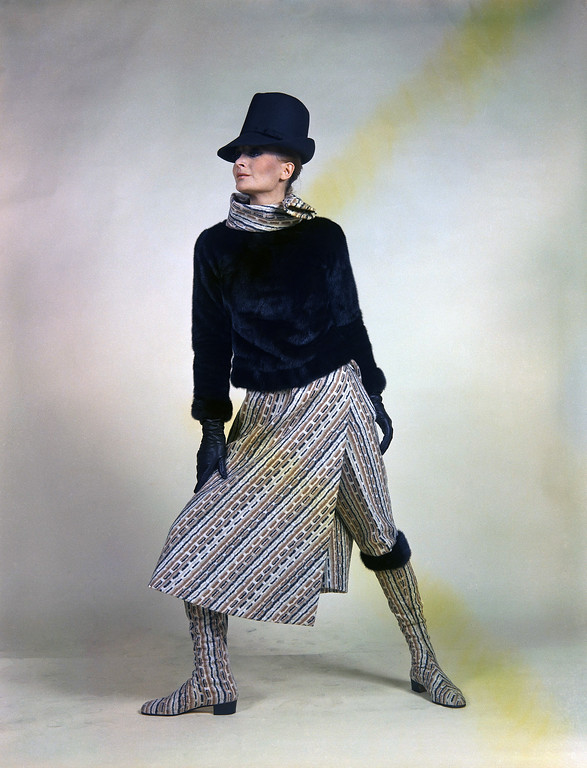 . A dress with long pants and long gown of beige, brown, black, ivory striped wool worn with a pullover jacket of black mink an a scarf of the same fabric as the gown, July 19, 1967. It is a creation by the Forquet fashion house of Rome for its autumn/winter 1967-68 collection. The hat by Canessa and the shoes by Barilla\', both of Rome. (AP Photo/Mario Torrisi)