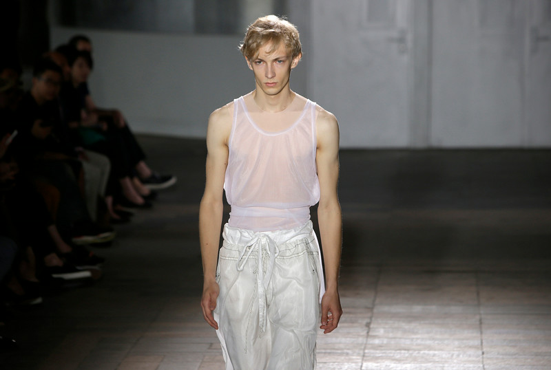 . A model wears a creation for Maison Martin Margiela men\'s spring-summer 2015 fashion collection presented in Paris, France, Friday, June 27, 2014. (AP Photo/Thibault Camus)