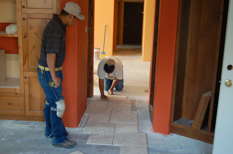 Laying out tile before installation begins.