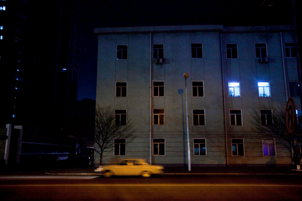 . A car drives along a street at night in central Pyongyang, North Korea on April 12, 2011. (AP Photo/David Guttenfelder)