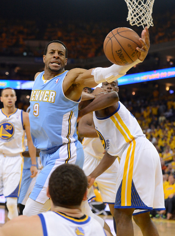 . OAKLAND, CA. - APRIL 26: Andre Iguodala (9) of the Denver Nuggets reaches out to save the ball from goin gout of bounds during the second quarter against the Golden State Warriors in game 3 of the first round of the NBA Playoffs April 26, 2013 at Oracle Arena.  (Photo By John Leyba/The Denver Post)