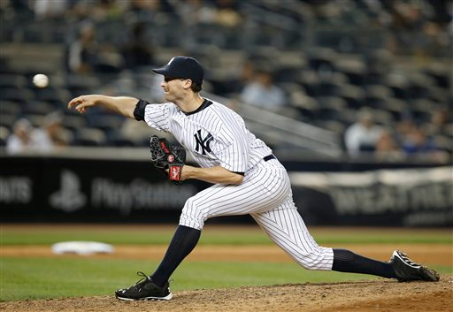 . New York Yankees relief pitcher Matt  Daley delivers in the 12th inning of a baseball game against the Detroit Tigers at Yankee Stadium in New York, Tuesday, Aug. 5, 2014.  Daley gave up the winning run to Detroit Tigers catcher Alex Avila, a solo home run. (AP Photo/Kathy Willens)