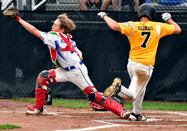 8/7/2019 Mike Orazzi | Staff Connecticut's Morris Selmani (7) out at home as Maine's Ethan Pelletier (14) takes the throw during Wednesday's New England Region Little League Baseball Tournament at Breen Field in Bristol, Conn.