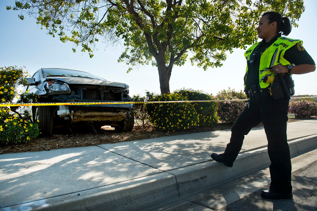 . A Chino Hills Police officer is on scene after pursuit that ended in 16600 block of Butterfield Ranch Road in Chino Hills on Friday, March 28, 2014. The suspect was later fatally shot by the deputies in a nearby neighborhood. (Photo by Watchara Phomicinda/ San Gabriel Valley Tribune)