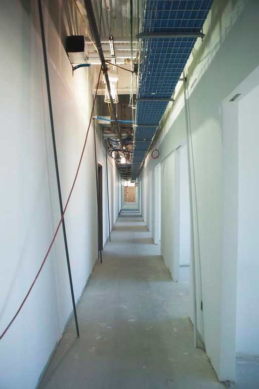 . Third floor hallway where the faculty offices are housed. There will be built in benches for students to wait for their appointments and a faculty lounge. (Photo by Jason Willis/Oakland University)