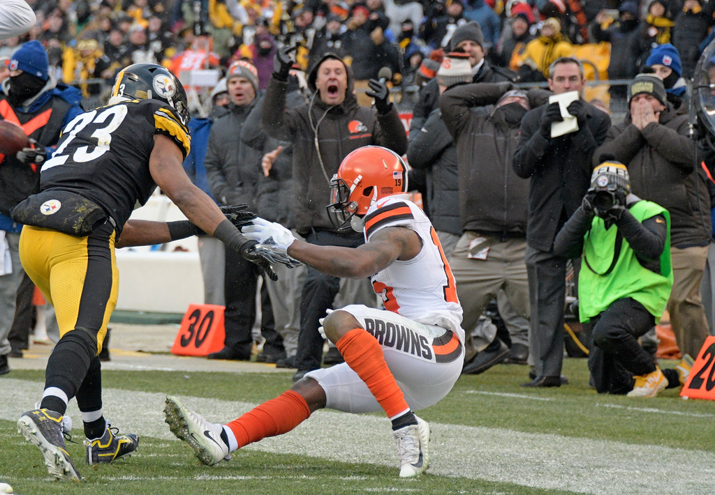 . Pittsburgh Steelers free safety Mike Mitchell (23) shoves Cleveland Browns wide receiver Corey Coleman, right, after a pass from quarterback DeShone Kizer went through his hands during the second half of an NFL football game in Pittsburgh, Sunday, Dec. 31, 2017. The Steelers won 28-24. (AP Photo/Don Wright)