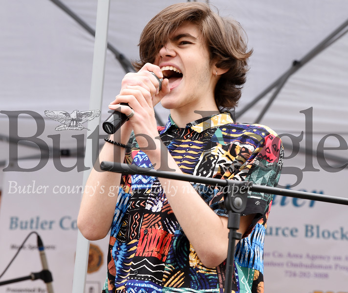 Harold Aughton/Butler Eagle: Lead vocalist of the band Palm Bodies, Noah Seese, 15, of Butler belts out a tune at the Butler County Recovery and Resource Block Party, Saturday, May 4.