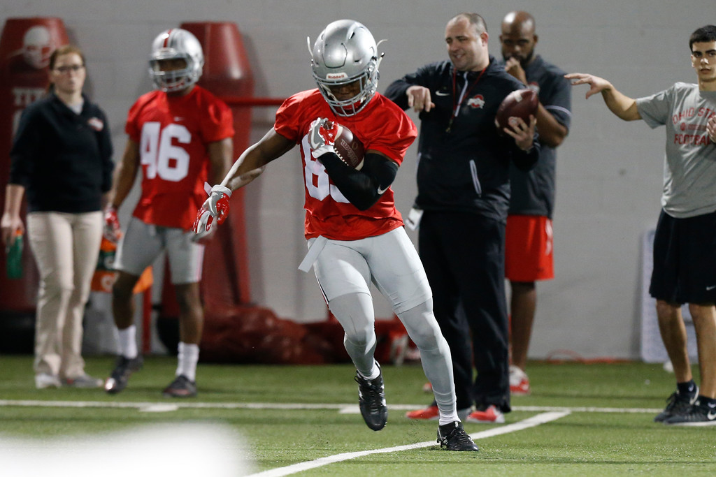 . Ohio State wide receiver Terry McLaurin runs the ball after a catch during spring NCAA college football practice Tuesday, March 7, 2017, in Columbus, Ohio. (AP Photo/Jay LaPrete)
