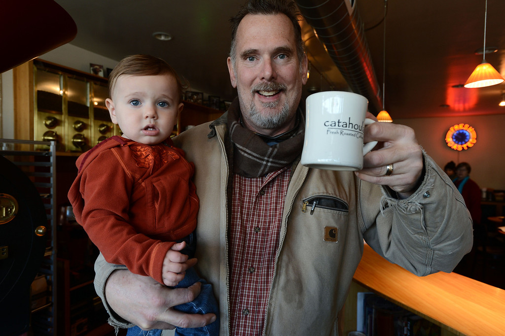 . Catahoula Coffee Company owner Tim Manhart holds 14-month-old son Nicholas at the coffee shop in Richmond, Calif. on Thursday, Jan. 17, 2013. (Kristopher Skinner/Staff)