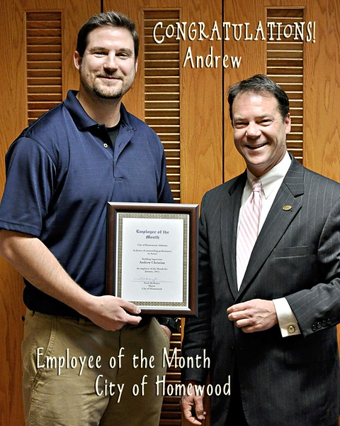 Andrew is presented the Employee of the Month award by Mayor McBrayer.jpg