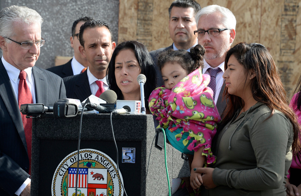 . San Fernando Valley Rescue Mission resident Nancy Arias, center, surrounded by her family and Los Angeles city officials, speaks at a May 8, 2014 press conference after a fire destroyed the mission\'s North Hollywood emergency shelter, vehicle fleet, clothing warehouse and food pantry. (Photo by Gene Blevins/Los Angeles Daily News)