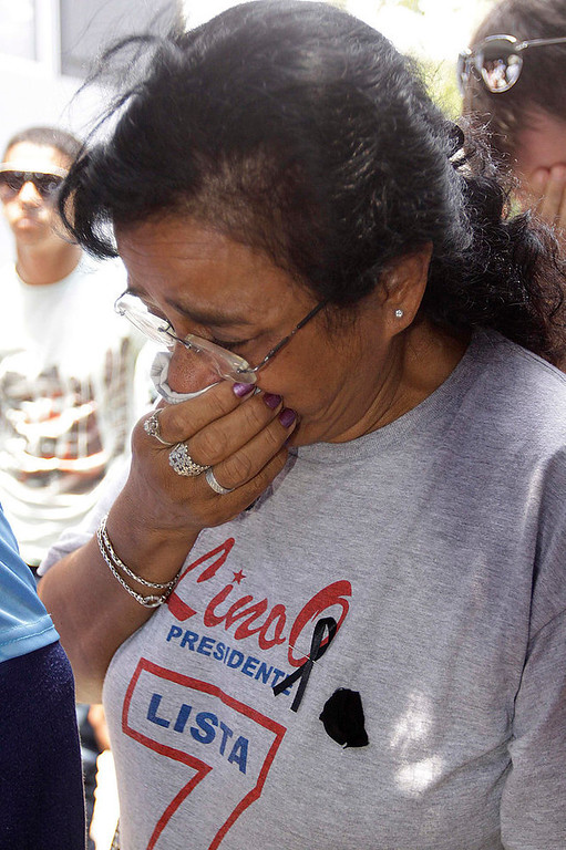 . A supporter of Paraguayan presidential candidate for the UNASE party Lino Oviedo reacts to his death, outside the campaign headquarters in Asuncion February 3, 2013. Oviedo, who led a 1989 coup that overthrew dictator Alfredo Stroessner, died in a helicopter crash over the weekend. Police rescuers found his body on Sunday in the wreckage of a helicopter crash in northern Paraguay where he was traveling for a campaign event. He was 69. REUTERS/Jorge Adorno