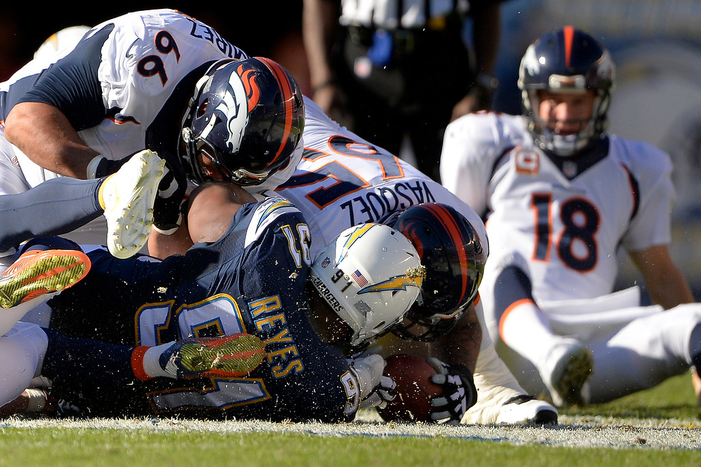 . SAN DIEGO, CA. December 14, - guard Louis Vasquez #65 of the Denver Broncos fights for a loose ball in the first half vs the San Diego Chargers at Qualcomm Stadium December 14, 2014 San Diego, CA (Photo By Joe Amon/The Denver Post)